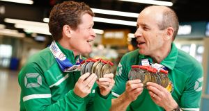 Top medal winners:  Deirdre Faul (liver recipient) from Dalkey,  and John Moran (kidney recipient) from Glasnevin arriving back to Dublin Airport from the World Transplant Games 2019. Photograph:  Conor McCabe