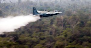 Brazilian air force    Hercules C130 plane dropping water on the Amazon forest in the state of Rondonia. Photograph: Brazil air force