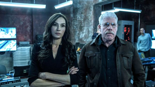 Famke Janssen and Ron Perlman in The Capture