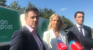 Garret Bridgeman, managing director of An Post mails and parcels with Minister for European Affairs Helen McEntee and Fergal O'Leary of the Competition and Consumer Protection Commission,  talk to the media at the  An Post Mail Centre in Portlaoise. Photograph: Cate McCurry /PA Wire