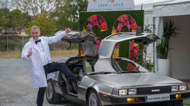 Back to the future: Rose of Tralee host Dáithí O'Sé poses with a DeLorean ahead of the show. Photograph: Domnick Walsh