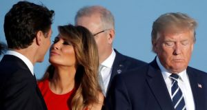 First lady Melania Trump kisses Canada's prime minister Justin Trudeau next to the US president Donald Trump during the family photo  at the G7 summit in Biarritz, France on Sunday. Photograph: Carlos Barria/Reuters
