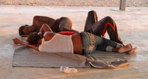 Rescued migrants sleep on the coast of Khoms, Libya. File Photograph: AFP/Getty