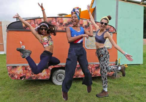 THE BUZZ IS ELECTRIC: From left are Karen Aguiar, Thais Muniz and Pati Guimaraes, all from Brazil, at Freetown in the Electric Picinic arena at Stradbally Hall. The annual music and arts festival takes place this weekend. Photograph: Colin Keegan/Collins Dublin