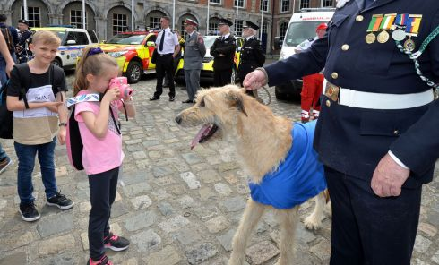 DOG ON DUTY: Eli (8) and Georgia Quarrel (6), from Melbourne, Australia, get a snap of  David Dixon with mascot dog Shannon and other members of the Frontline Emergency and Security Services Eire Forum, announcing details of the National Support Services Parade and Concert, on September 7th next. The forum promotes links between the State's security and emergency services, and promotes their respective roles to the public. Photograph: Alan Betson
