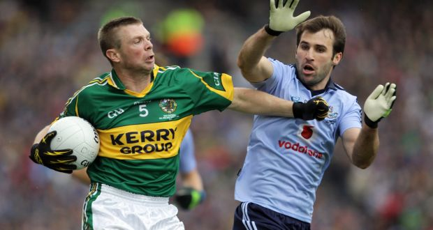 Tomas O'Se of Kerry with Bryan Cullen of Dublin in the  All-Ireland SFC final in 2011. Photograph: Donall Farmer/Inpho