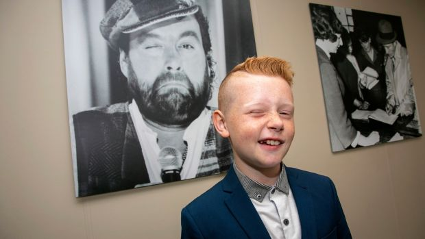 The late Brendan Grace's grandson James Gillespie (11) at The Wall of Fame at Shannon Airport on Tuesday. Photograph: Arthur Ellis.