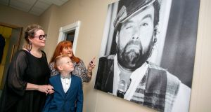 The late Brendan Grace's  daughter Amanda, grandson James Gillespie (11) and wife Eileen, at The Wall of Fame at Shannon Airport on Tuesday. Photograph: Arthur Ellis.