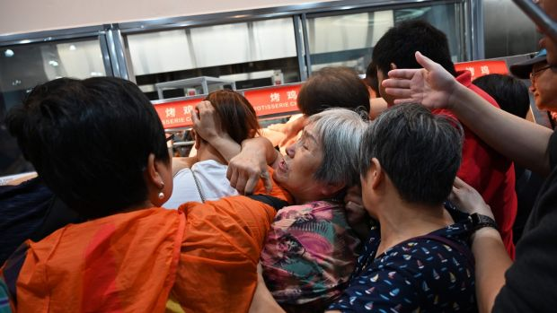 People trying to get a roast chicken at the first Costco outlet in China on Tuesday. Photograph: Getty Images