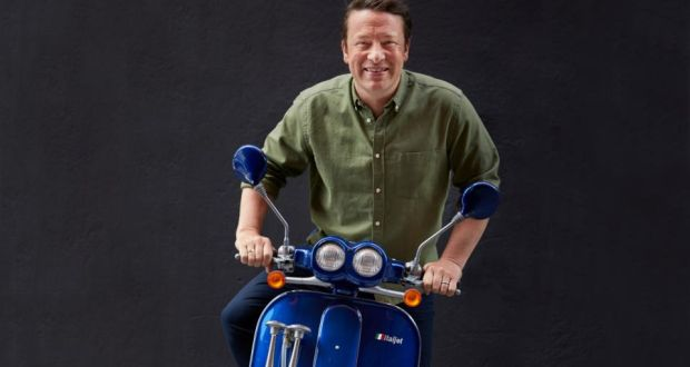 Jaime Oliver, the British TV chef, on the motor scooter that he made famous on his first TV show, The Naked Chef. Photograph: John Kernick/The New York Times