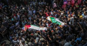 Palestinians carry two bodies of the three Hamas policemen killed in bomb blasts a day earlier during their funeral in al Omari mosque, Gaza City. Photograph: Mohammed Saber/EPA