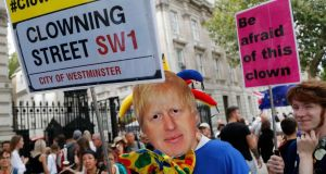 A protestor wearing a Boris Johnson mask demonstrates outside Downing Street on Wednesday. Photograph: Frank Augstein/AP