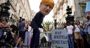 A protester depicting British prime minister Boris Johnson demonstrates at a protest outside Downing Street in London on Wednesday. Photograph: Will Oliver/EPA