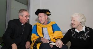 Fr Tony Coote was conferred with an honorary doctorate of science by UCD last December. He is pictured here with Archbishop of Dublin Dr Diarmuid Martin and his mother Patricia. Photograph: Colm Mahady/Fennells