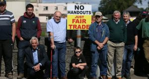 Farmers and supporters outside Meadow Meats in Rathdowney, Co Laois, where protests are continuing after farmers rejected the outcome of talks last week aimed at securing better beef prices. Photograph: PA
