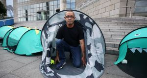 Andy O'Driscoll, a volunteer with Inner City Helping Homeless, during its protest outside Dublin City Council Offices on Wood Quay to highlight the number of people living in tents. Photograph: Brian Lawless/PA Wire