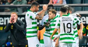 Celtic's James Forrest (middle) celebrates with team-mates after opening the scoring in the Europa League qualifier playoff second leg against AIK at Friends Arena in Stockholm, Sweden. Photograph: Jonas Ekstromer/AFP/Getty Images