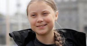 Climate change activist Greta Thunberg addresses the media during a news conference in Plymouth, England. Thunberg has crossed the Atlantic on a zero-emissions sailboat to attend a conference on global warming. Photograph: Kirsty Wigglesworth/AP Photo