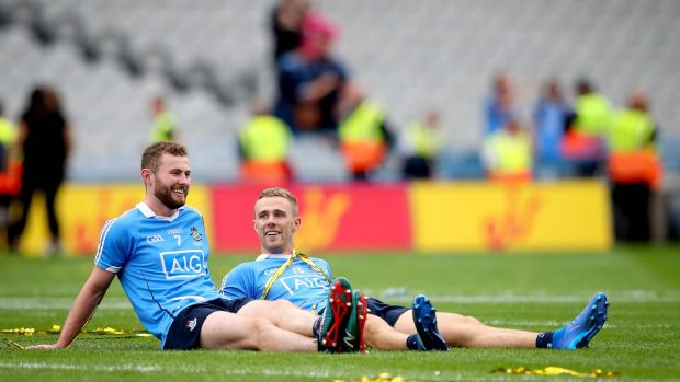 Jack McCaffrey and Paul Mannion take in the celebrations after the 2018 final win over Tyrone. Photo: Ryan Byrne/Inpho