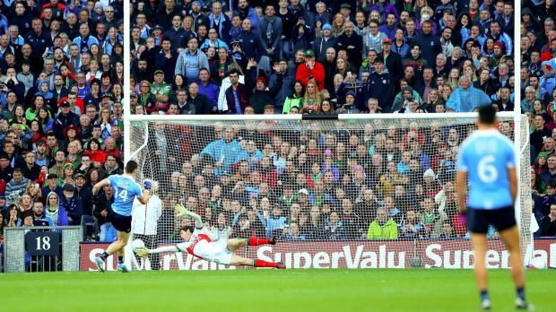 Diarmuid Connolly scores his side's first goal past goalkeeper David Clarke during the 2016 final replay. Photo: James Crombie/Inpho