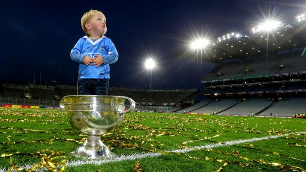Denis Bastick sons Aidan in the Sam Maguire after Dublin beat Mayo in the 2016 final replay. Photo: James Crombie/Inpho