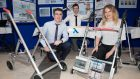 Students Cian O'Leary, Kevin Hayes,  and Muireann Hickey with their mobility aid to assist users stand from a seated position. Photograph: Darragh Kane