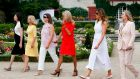 The G7 wives: the message is that women don't really have business of their own. Photograph: Regis Duvignau/AFP/Getty