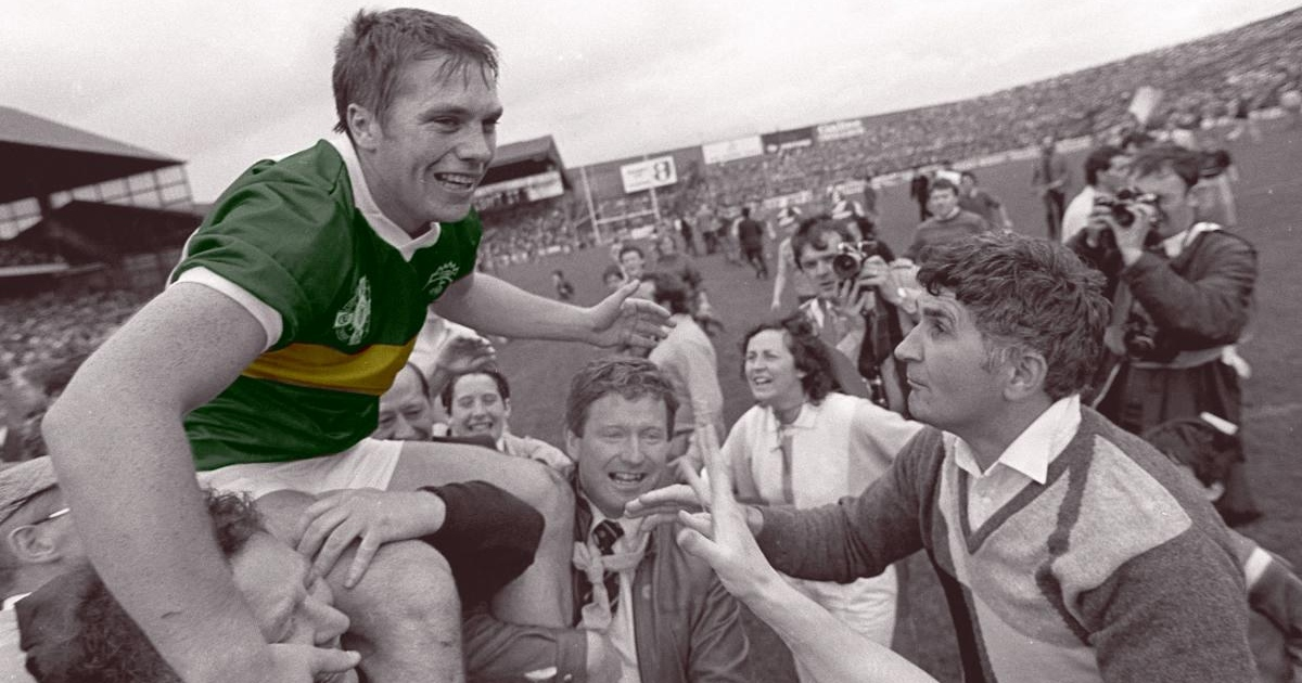Kerry's Páidí Ó Sé is held aloft by supporters after Kerry's victory over Dublin in the 1985 All-Ireland Football final. Ready to greed him is Kerry manager Mick O'Dwyer. Photograph: Ray McManus/Sportsfile