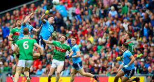 Brian Fenton and Michael Darragh Macauley attack a Mayo kickout in the semi-final. Photogaph: Tommy Dickson/Inpho