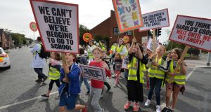 Campaign group ETHX during Friday's protest. Spokeswoman Roisin Kelly said many pupils end up passing Harold's Cross and crossing the city to access multidenominational secondary schools. Photograph: Alan Betson