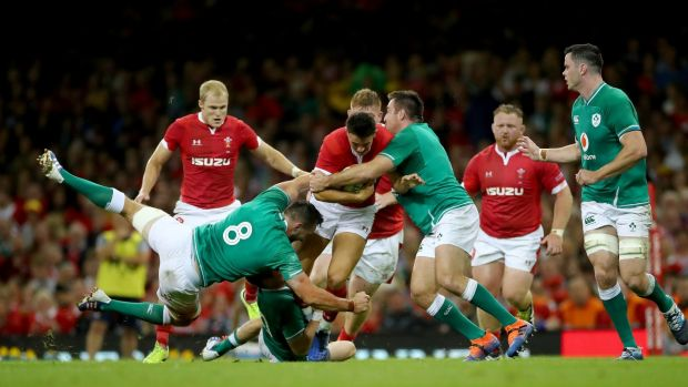 Jack Conan, Jack Carty and Niall Scannell tackle Owen Watkin of Wales. Photograph: James Crombie/Inpho
