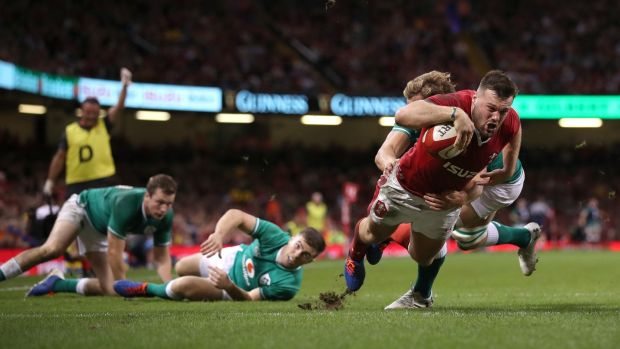 Wales wing Owen Lane dives over to score their first try. Photograph: Stu Forster/Getty Images
