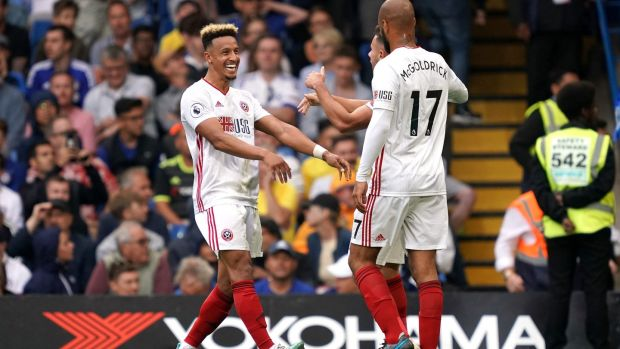 Sheffield United's Callum Robinson celebrates with Ireland teammate David McGoldrick after creating his side's late equaliser at Stamford Bridge. Photograph: John Walton/PA