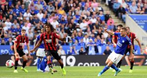 Jamie Vardy scores Leicester's third against Bournemouth. Photograph: Ross Kinnaird/Getty