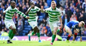 Jonny Hayes celebrates after scoring Celtic's second against Rangers at Ibrox. Photograph: Mark Runnacles/Getty