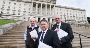 (From left)  Lord Empey, Robin Swann and Steve Aiken of the Ulster Unionist Party outside Stormont Parliment buildings. Photograph: PA