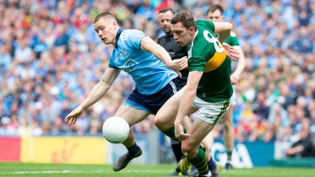 David Moran contests for possession with Con O'Callaghan. Photograph: Tom Honan