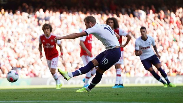 Harry Kane extend's Tottenham's lead from the penalty spot. Photograph: Will Oliver/EPA