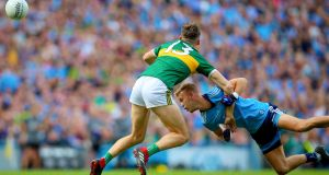 Dublin's Jonny Cooper fouls David Clifford of Kerry - he was shown a second yellow card as a result. Photograph: Tommy Dickson/Inpho