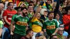 FULL-THROATED APPROVAL: Kerry fans celebrate a score againt Dublin during the All-Ireland senior football final at Croke Park. Photograph: Dara Mac Donaill