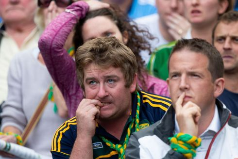 DOWN TO THE WIRE: Kerry fans tough it out during the tense final moments of the All-Ireland final against Dublin in Croke Park. The result was a draw. Photograph: Tom Honan