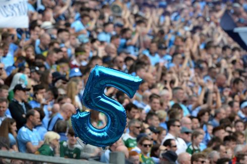 FIVE IN A ROW? A hopeful blue No 5 floats above the Hill at Croke Park above a sea of Dubs fans during the Dublin vs  Kerry All-Ireland senior football final, which will have to be replayed after Sunday's draw. Dublin are hoping to secure a fifth consecutive All-Ireland championship. Photograph: Dara Mac Donaill