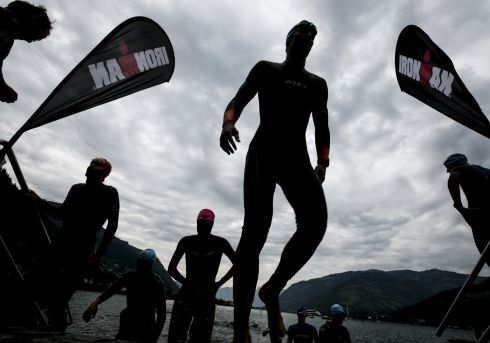 IRON WILL: Athletes emerge from the swim leg of the Ironman 70.3 Zell am See competition in Salzburg, Austria. Photograph: Jan Hetfleisch/Getty