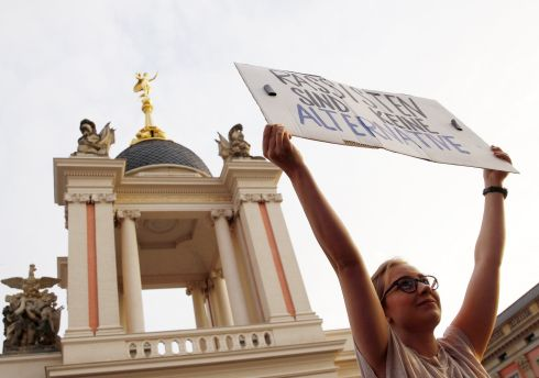 "ALTERNATIVE VOICE: A protester holds a placard reading ""Racists are not an alternative"" outside the Landtag or regional parliament, in Potsdam, Germany, where a TV talk show featuring election candidates took place after initial exit polls of the Brandenburg state elections were announced on Sunday. Photograph: Michele Tantussi/Getty"