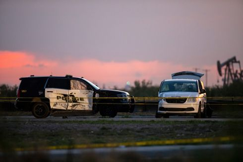 AFTERMATH OF A SHOOTING: An Odessa police vehicle vehicle and US postal van, which was stolen by a gunman involved in a mass shooting, in Odessa, Texas. A city spokesman said seven people were killed, in addition to the gunman. At least 21 others were wounded. Photograph: Ivan Pierre Aguirre/New York Times