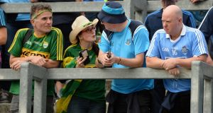 Still friends: Dublin and Kerry fans chat after the All-Ireland senior football final in Croke Park. Photograph: Dara Mac Dónaill