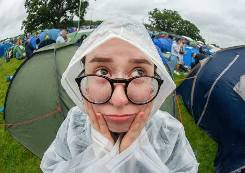 Lina Bebekh, from Clondalkin, Dublin, braves the rain at Electric Picnic on Saturday.  Photograph: Dave Meehan/The Irish Times