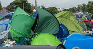 Discarded camping equipment and unmoored tents blown by the wind piling up at an Electric Picnic campsite on Monday afternoon. Photograph: Dave Meehan for the Irish Times