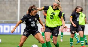 Katie McCabe and Louise Quinn in action during a Republic of Ireland training session at Tallaght Stadium ahead of Tuesday night's European Championship qualifier against Montenegro. Photograph:  Morgan Treacy/Inpho