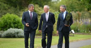 Minister of State for Agriculture Andrew Doyle,  Minister for Communications, Climate Action and Environment Richard Bruton, and   Mark McAuley, director of Forest Industries Ireland, in Dublin's Botanic Gardens. Photograph: Dara Mac Dónaill/The Irish Times